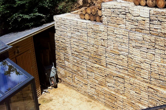 Private property - the house was built into a steep embankment needing a strong wall so a Devoran Garden Gabions were used - the use of the gabion produced a beautiful wall