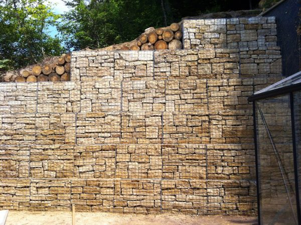 Large gabion wall retaining a crumbling embankment in Hobscheid, Luxembourg.