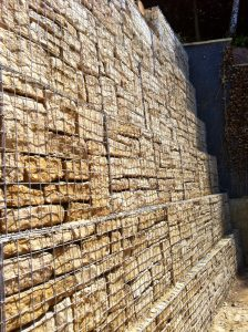 Gabion wall that has been stepped at each course to improve stability.
